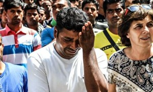 Strawberry picker in tears amid crowd